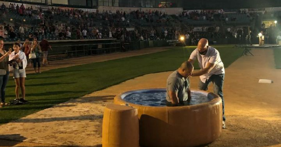 A man being baptized, revival is happening in California
