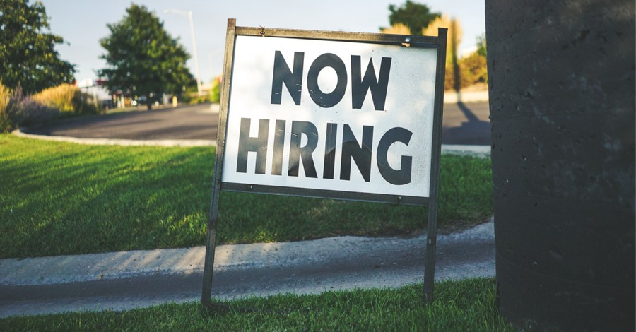 Now Hiring sign, Nearly 2 million jobs have been added in the US
