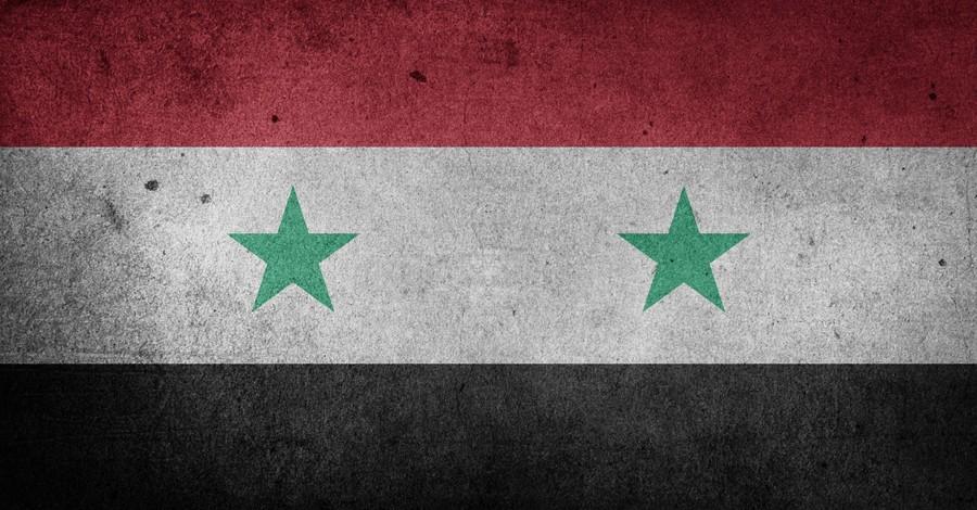 Syrian flag, school headmaster is facing a possible execution for his Christian faith