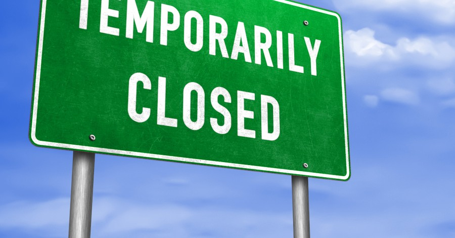 road sign temporarily closed due to COVID-19
