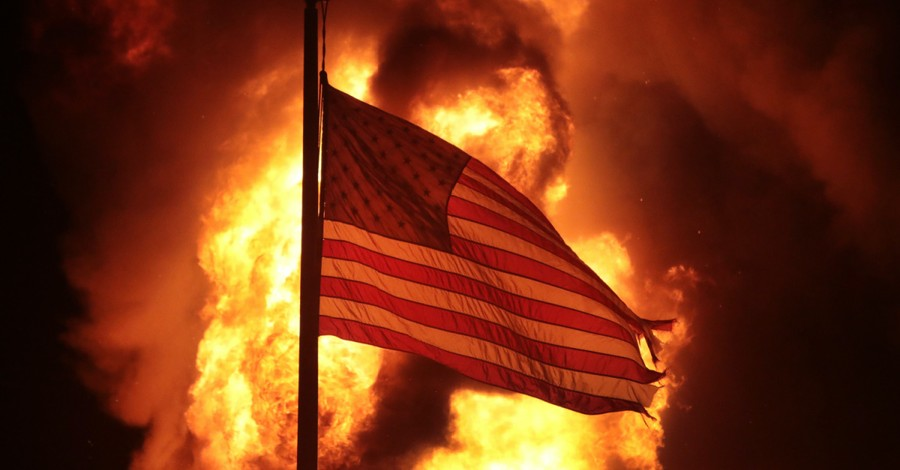 A fire behind an American flag, faith leaders speak out against the shooting of a Black man and the riots that followed