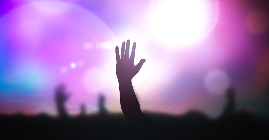 hand raised in praise at concert or performance celebrity idol worship