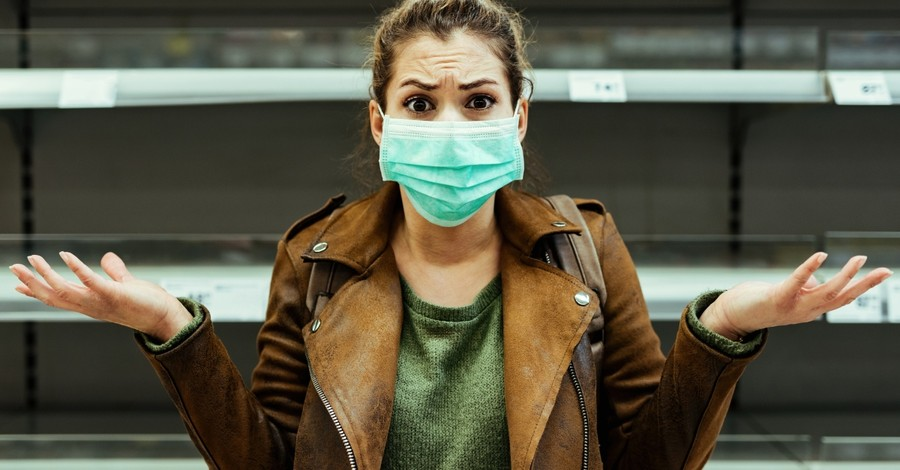 woman angry and upset with coronavirus face mask on