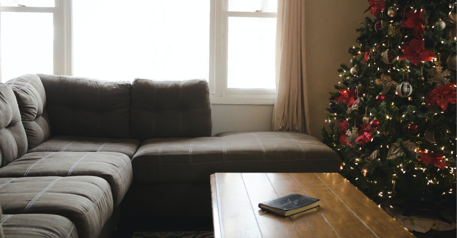 A living room with a Christmas tree and a Bible on the table, HUD investigates religious liberty complaint