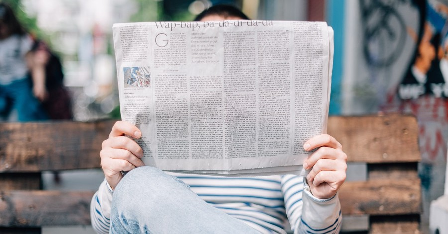 A person reading a newspaper, three urgent problems and three biblical responses