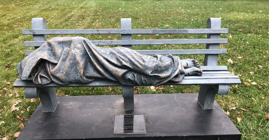 A statue of Jesus sleeping on a bench, Man calls cops on statues of a homeless and sleeping Jesus