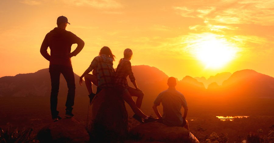 group of people marveling at sunrise, why the division of the sacred and secular is damaging