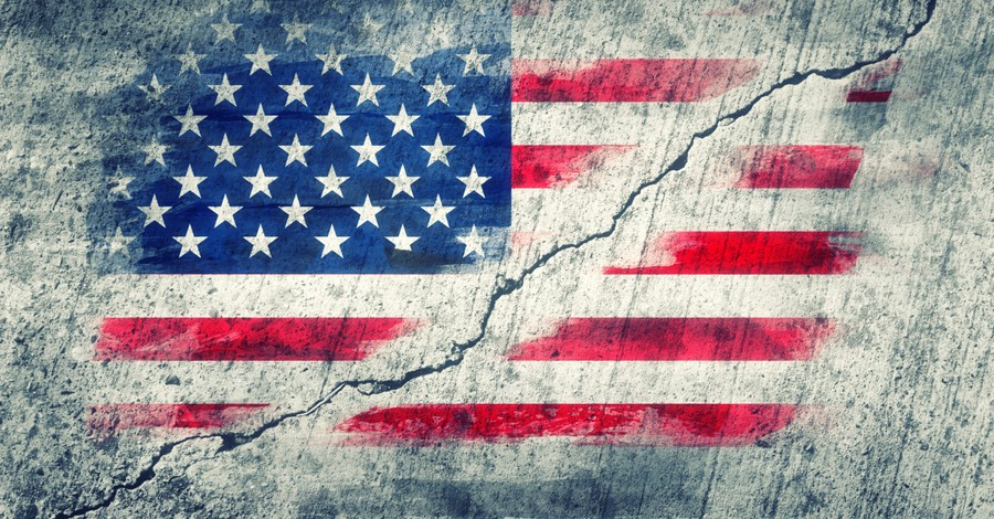american flag painted on wall that is cracked to signify divisive politics in election season
