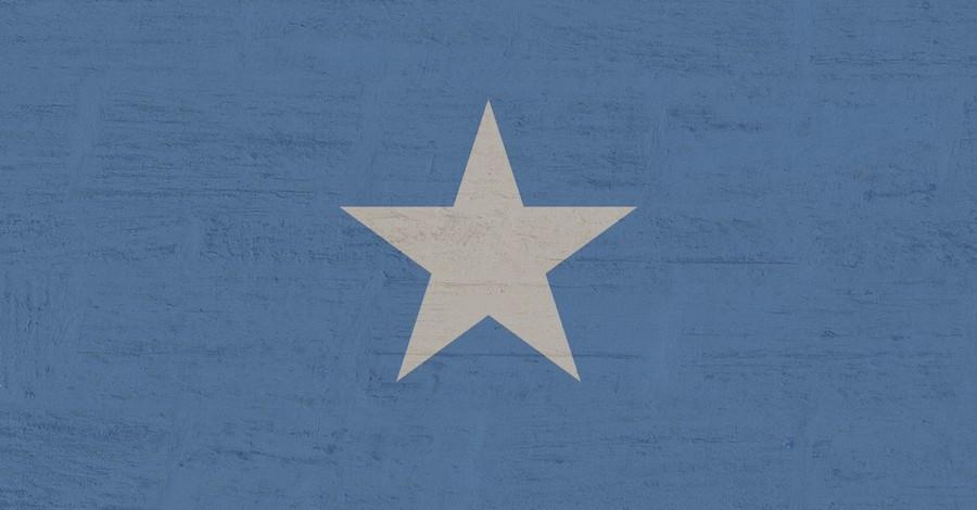 Somalia flag, a Christian boy is attacked by Muslim teens