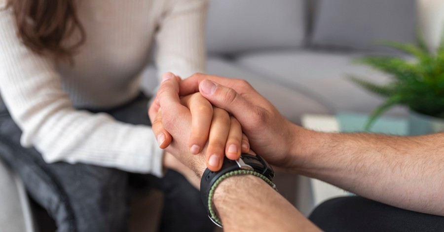couple holding hands in prayer support forgiveness slow to anger