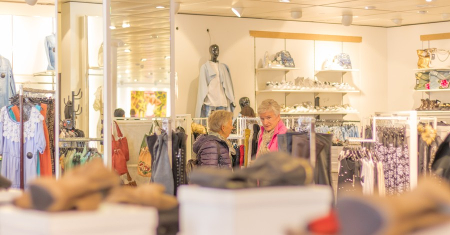 inside of a clothing store, megachurch buys $20 million shopping center