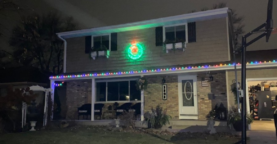 A house with a strand of lights and a lit wreath, Person sends critical letter to woman over her Christmas lights