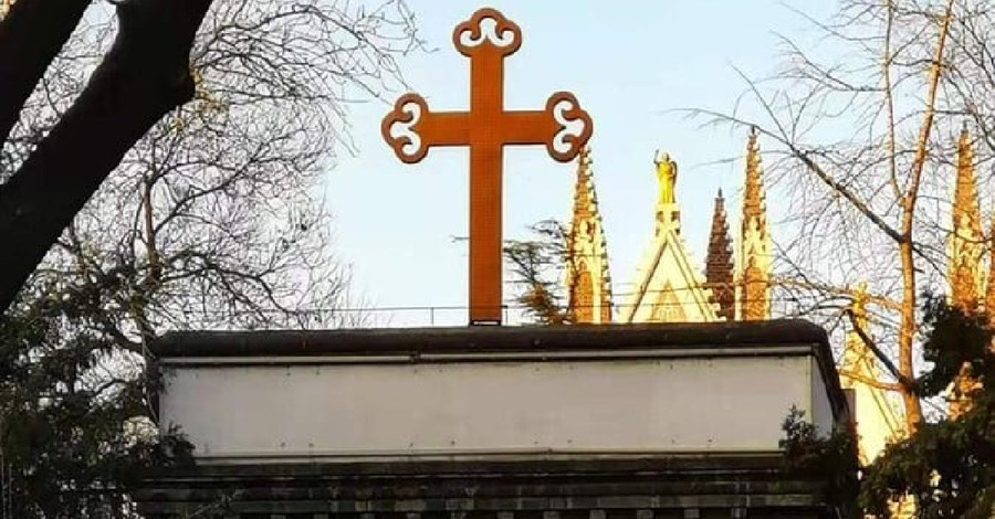 a cross on a church in China, Christians are met with anti-Christmas protests
