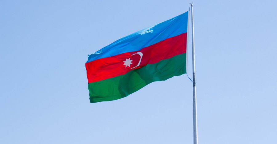 Azerbaijan flag, Christian persecution watchdog group says Armenian Christians are being killed and displaced