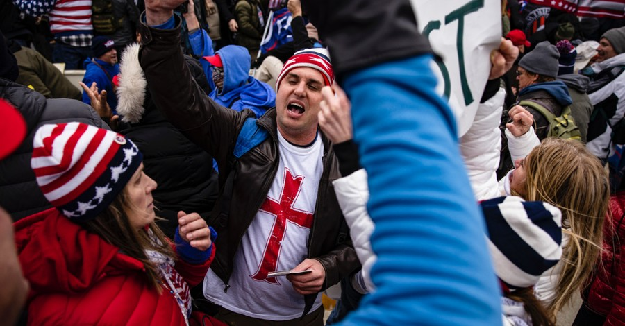 A man wearing a shirt with a Red Cross at the capitol riots, Was the riot at the Capitol a Christian Insurrection