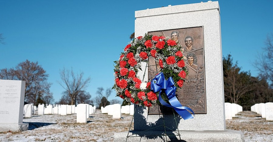 A wreath stands next to the NASA Challenger Memorial in winter