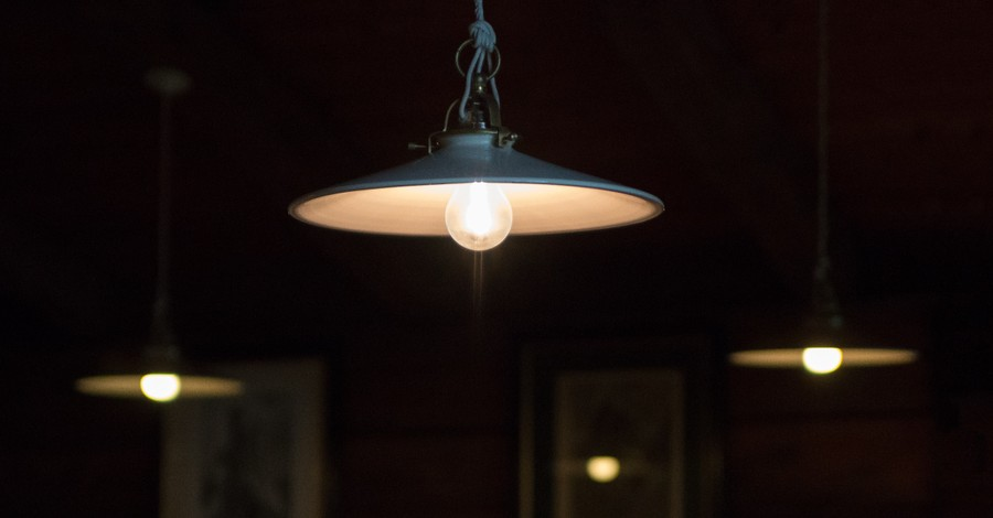 a hanging light, church raises over $100000 to help families in need pay off their electricity bills