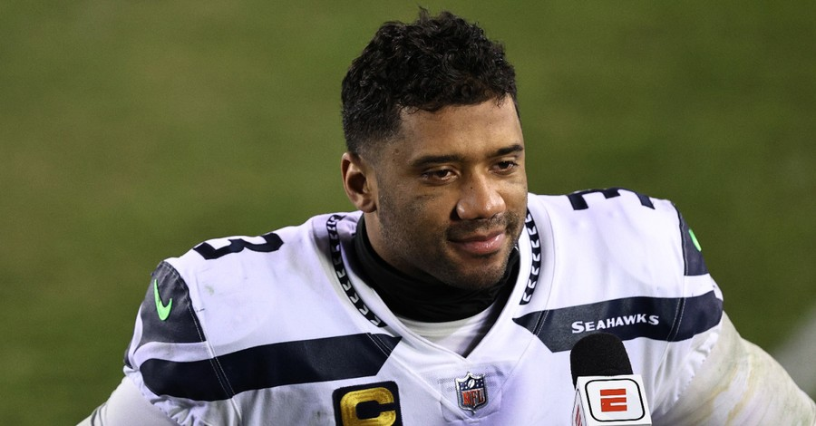 Russell Wilson, Wilson partially quotes 1 Corinthians while accepting the Walter Payton Man of the Year award