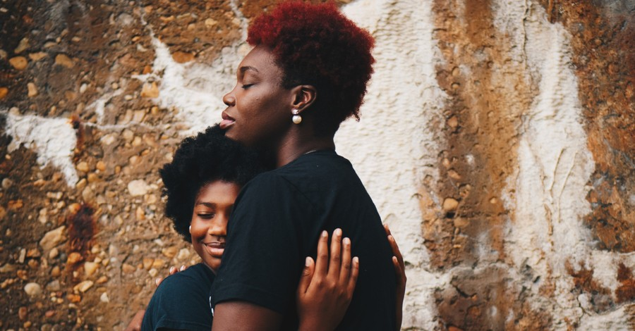 a mother and daughter hugging, how Christians should view critical race theory