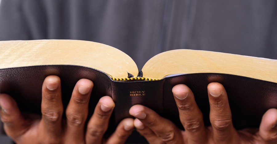a man holding a Bible, Pastors Are Leaving Their Churches over Congregants' Belief in QAnon Conspiracies