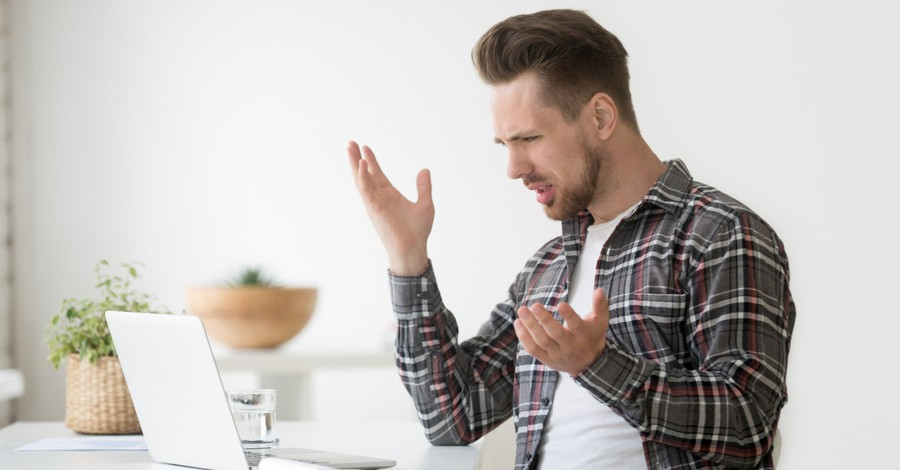 A man using his computer frustratedly, Evangelical Self Flagellation Isn't Prophetic Witness
