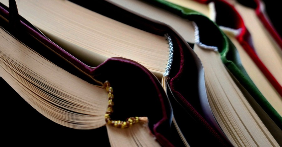 A stack of books, Tenn. Lawmaker introduces legislation banning LGBT content from being taught in schools