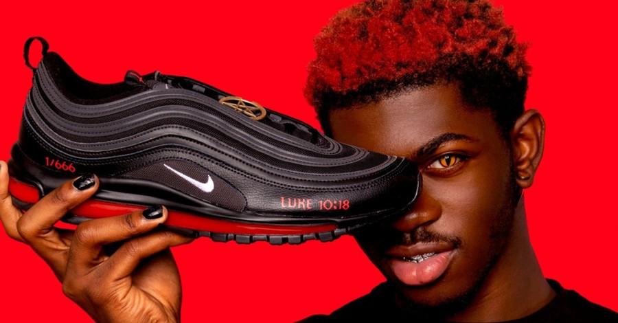 Lil Nas X holding his Montero sneakers