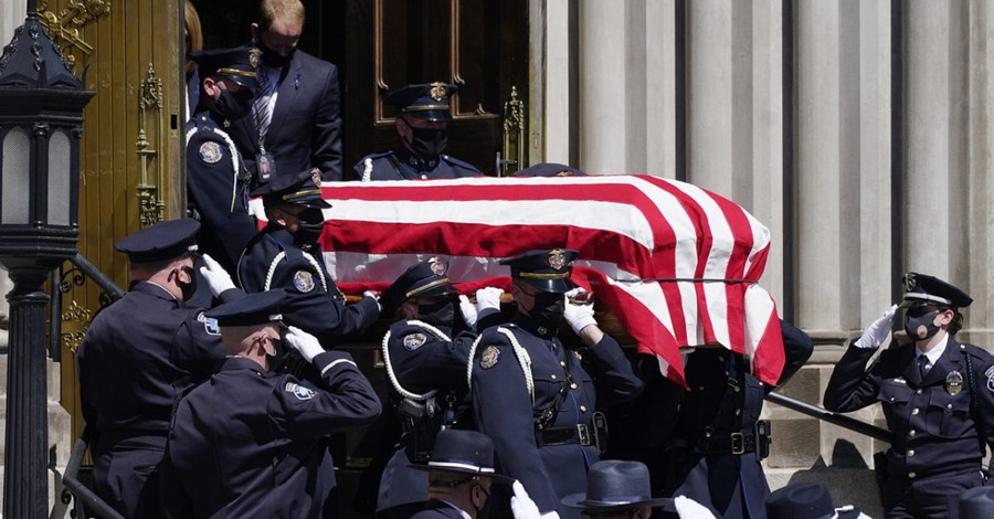 Officer Eric Talley's coffin being carried out, Eric Talley honored in Catholic funeral Mass