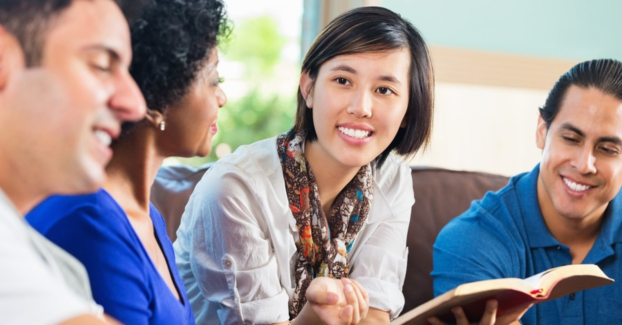A woman holding a Bible and talking to friends, Three steps to conversations that affect eternity