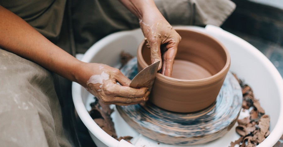 a potter throwing clay, join the Engage Art Contest