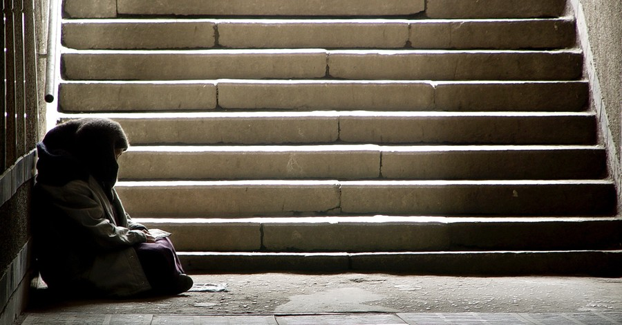 A homeless person sitting outside, A formerly homeless man praises God for turning his life around