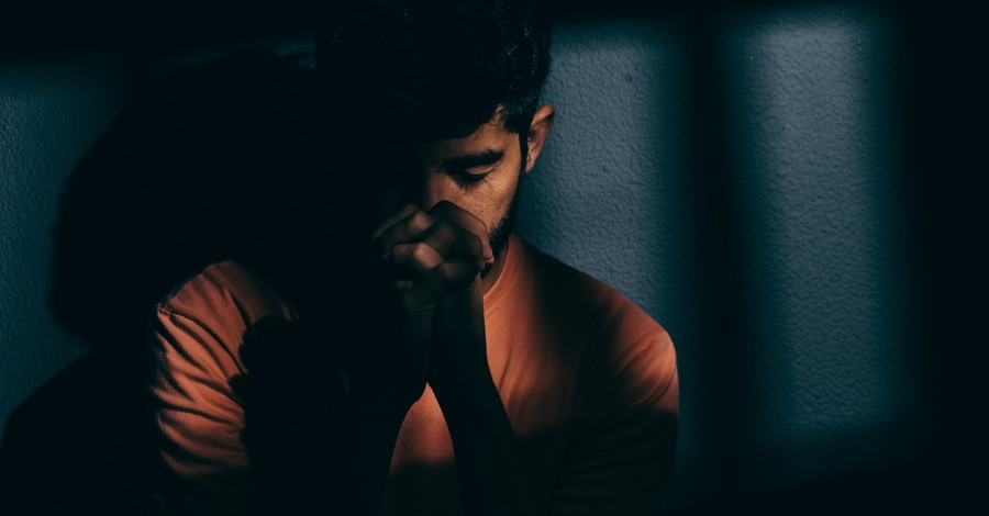 A man wearing orange and praying, Why the church must be like Nehemiah and pray before we act
