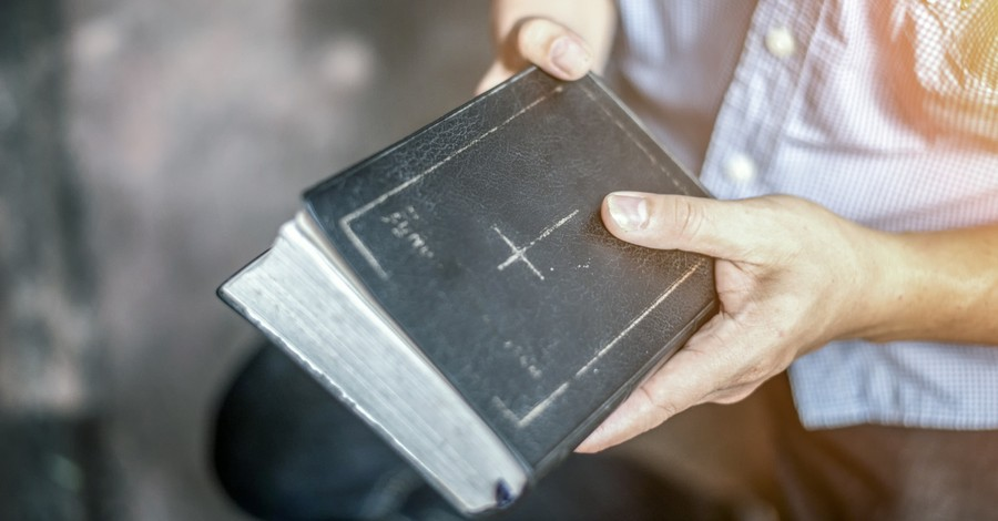 a man holding a Bible, Harvest Bible Chapel hires new lead teaching pastor