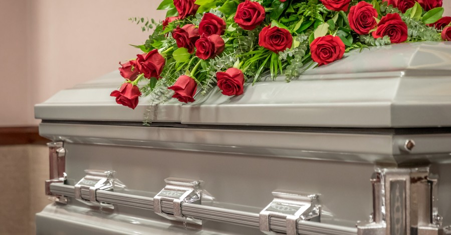 Casket with roses on it, A pastor dies after a plane crashed into his family home