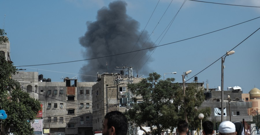 An explosion from a missile in Israel, Hamas shoots hundreds of missiles at Israel