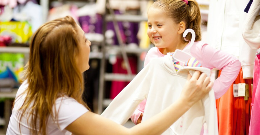 a woman and daughter clothes shopping, mandating gender-neutral retail departments