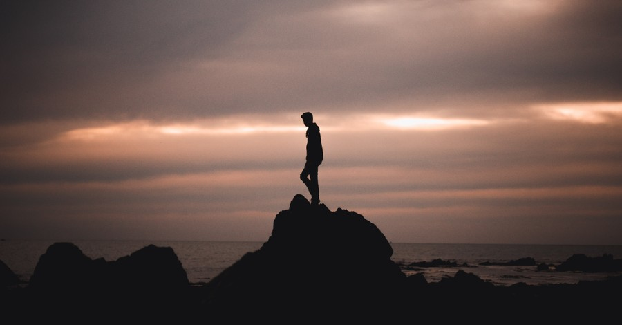 a man on a rock, You are a body... not in one