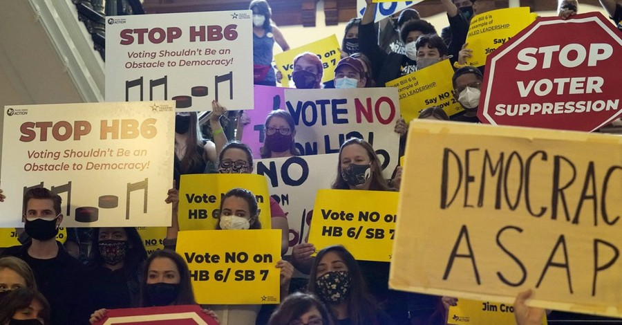 People protesting voter laws, new voter laws are a body blow to American democracy