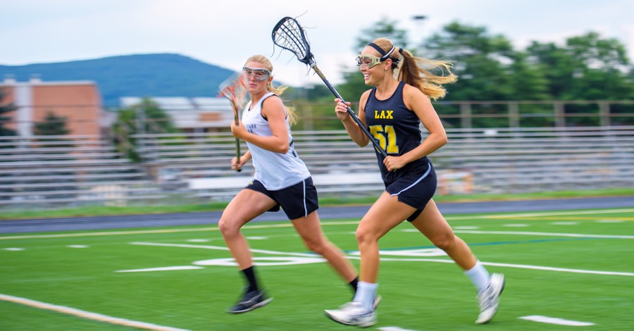 Girls playing lacrosse, The Biden Administration vows to allow transgender athletes in women's sports
