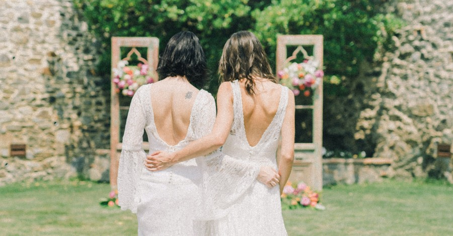 Two women getting married, 70 percent of Americans support same-sex marriage