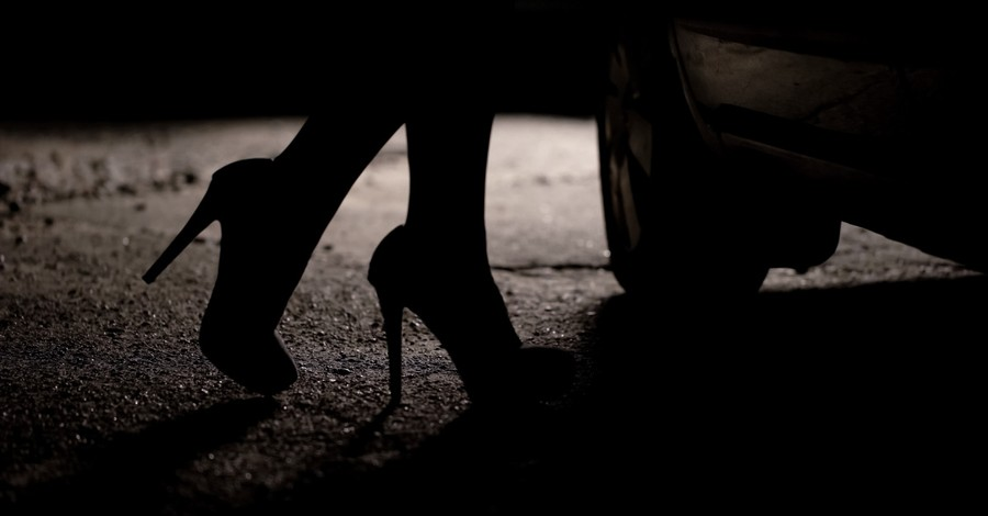 a woman in a pair of heels, should prostitution be legal?