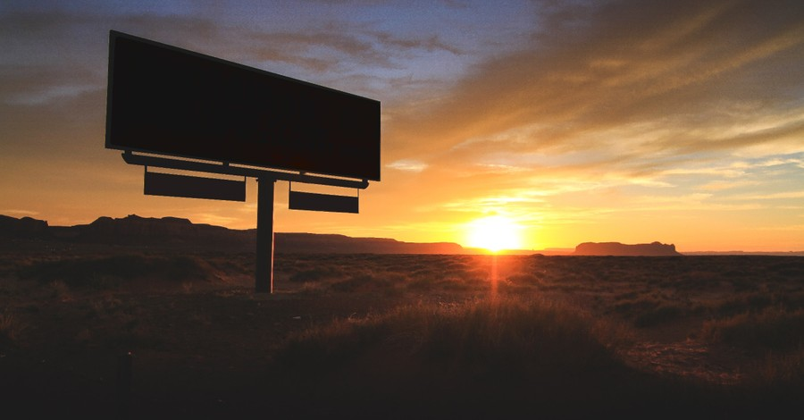 A billboard at sunset, Man contemplated suicide is reminded of God's love and changes his mind