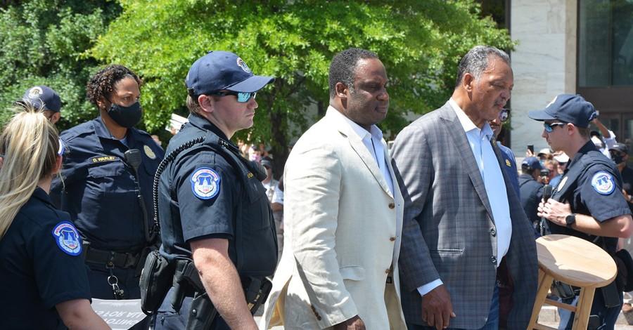 Jesse Jackson and Rev William Barber being arrested, Jackson and Barber are arrested during protest