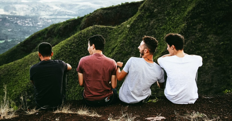 Four guys hanging out, Survey shows that men today have fewer friends than they did in the 90s