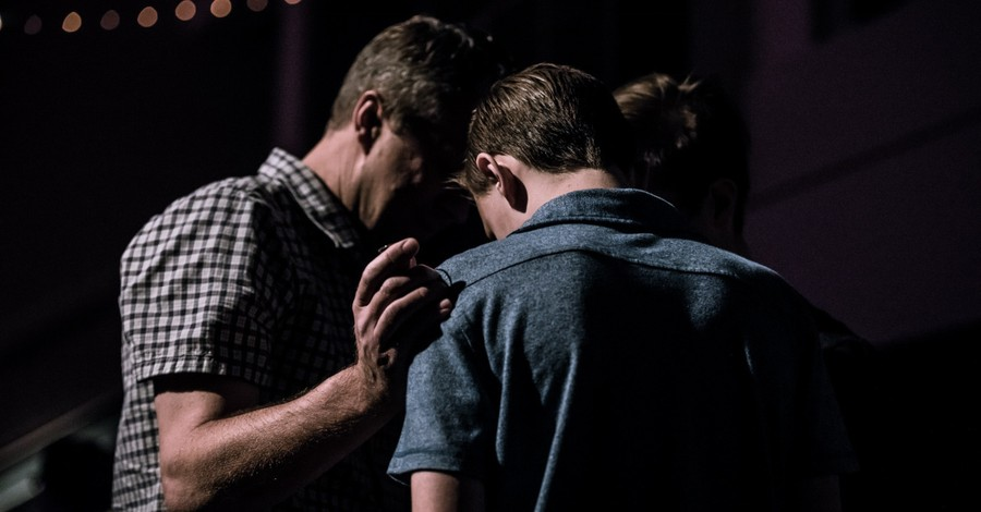 men praying, What the church can learn from AA