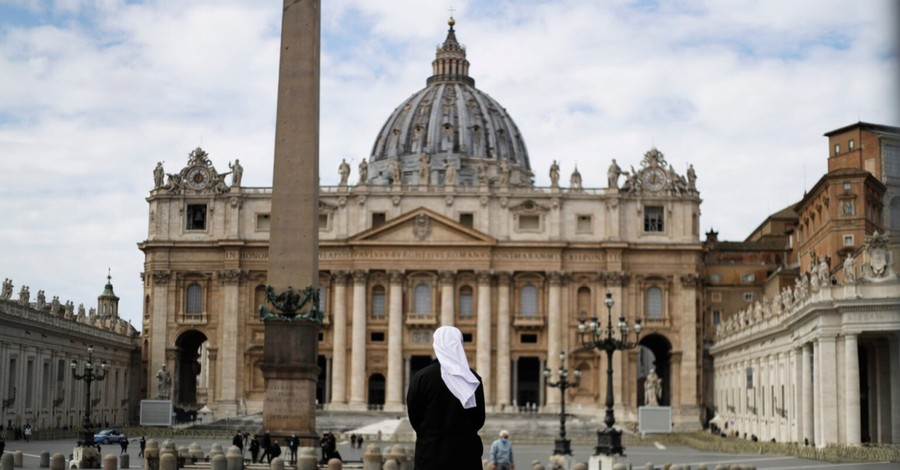A nun outside of the Vatican building, historic Vatican trial may change the Catholic Church's finances forever