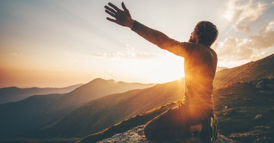 A man worshipping on a mountain, Worshipping God's creation over God
