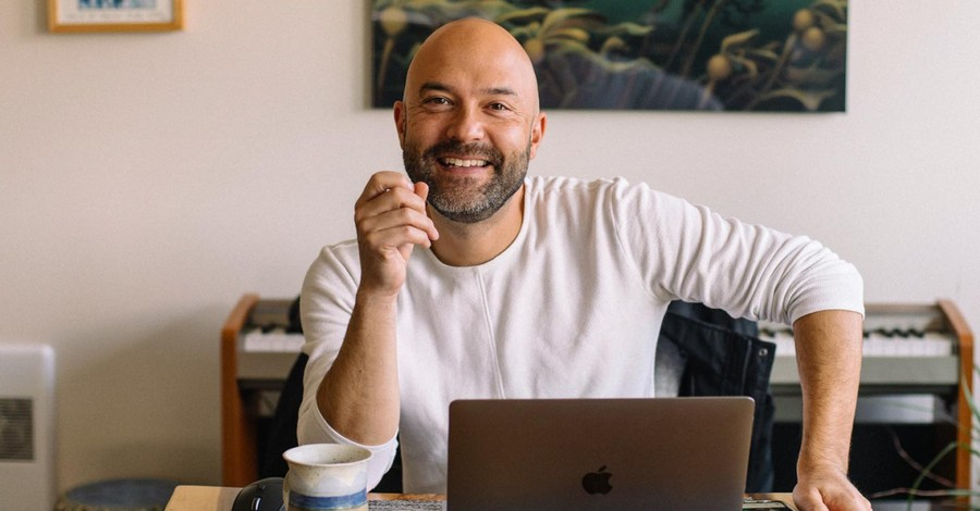 Joshua Harris sitting at a table, Harris launches course on 'deconstructing' your faith