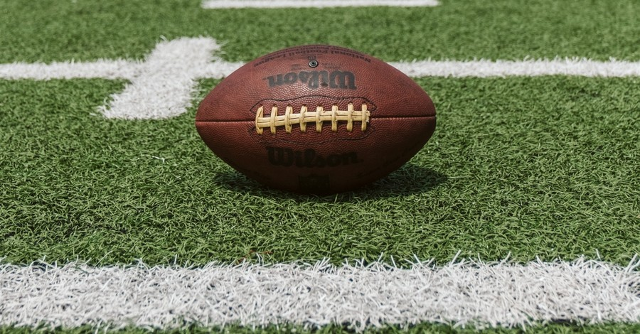 Football sitting on a field