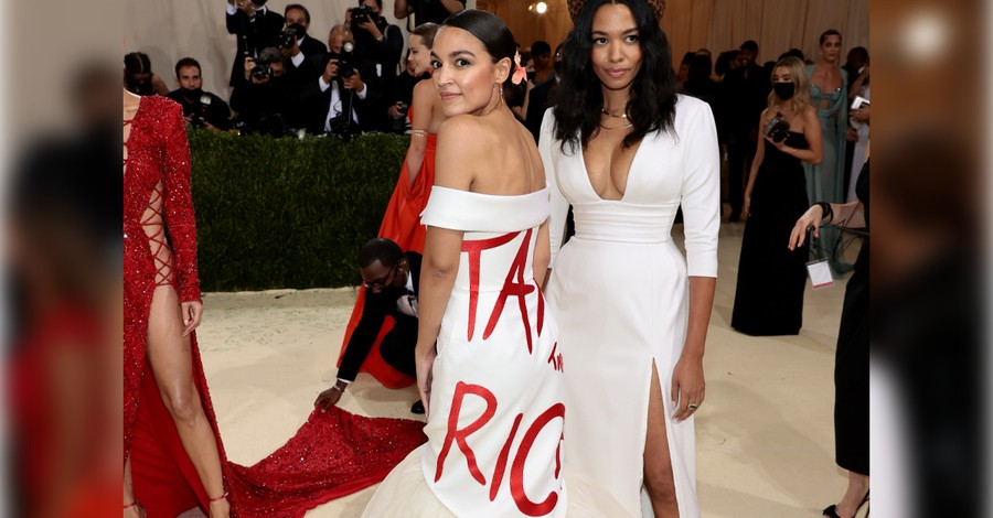 AOC wearing a Tax the Rich dress at the Met Gala, AOC at the Met Gala